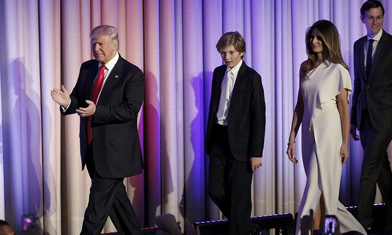 US President-elect Donald Trump greets supporters along with his wife and family during his election night rally.