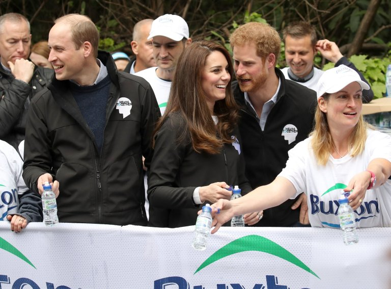 The Duke and Duchess of Cambridge and Prince Harry hand out water to runners during the 2017 Virgin Money London Marathon. PRESS ASSOCIATION Photo. Picture date: Sunday April 23, 2017. See PA story SPORT Marathon. Photo credit should read: Chris Jackson/PA Wire