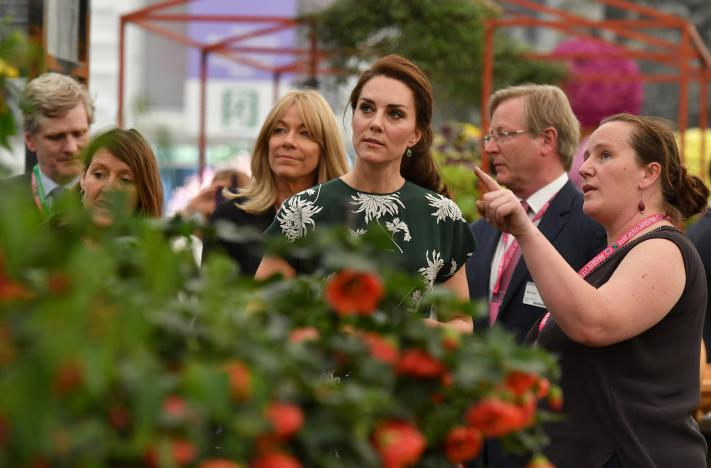 Britain's Catherine, Duchess of Cambridge (C), talks to an exhibitor (R) as she visits the Chelsea Flower Show in London, Britain on May 22, 2017. REUTERS/Ben Stansall/Pool