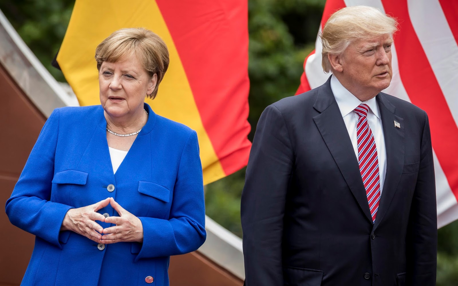 """German Chancellor Angela Merkel stands next to US President Donald Trump during the """"family portrait"""" at the G7 summit in Taormina in Sicily, Italy, 26 May 2017. The heads of the G7 states meet in Sicily from 26 May until 27 May 2017 to negotiate and talk about global topics. Photo by: Michael Kappeler/picture-alliance/dpa/AP Images"""