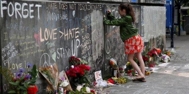A girl leaves a message at a makeshift memorial for two men who were killed on a commuter train while trying to stop another man from harassing two young women who appeared to be Muslim, in Portland, Oregon. REUTERS/Terray Sylvester