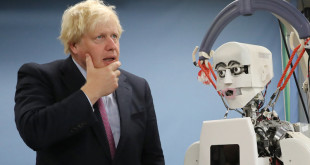 Britain's Foreign Secretary Boris Johnson gestures as he looks at a humanoid robot at Research Institute for Science and Engineering at Waseda University's Kikuicho Campus in Tokyo Thursday, July 20, 2017. REUTERS/Eugene Hoshiko/Pool