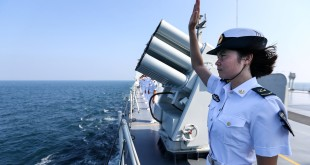 A Chinese soldier waves farewell to Russian fleets as the Chinese-Russian joint naval drill concludes in Zhanjiang, Guangdong Province, China, September 19, 2016. REUTERS/Stringer ATTENTION EDITORS - THIS IMAGE WAS PROVIDED BY A THIRD PARTY. EDITORIAL USE ONLY. CHINA OUT. NO COMMERCIAL OR EDITORIAL SALES IN CHINA.   - RTSOJ3R