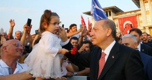 "A handout photo released by the Turkish Presidential Press Service shows Turkish President Recep Tayyip Erdogan greeting a young girl at the 'July 15 Martyrs' Monument' during its inauguration at the Presidential Complex in Ankara on July 16, 2017, as part of the events held to mark one year since the July 15 defeat of the failed coup bid. Turkey on July 15 marked one year since the defeat of the failed coup bid with mass nationwide rallies seeking to showcase national unity and a stern warning by President Recep Tayyip Erdogan to ""chop off the heads"" of traitors. / AFP PHOTO / TURKISH PRESIDENTIAL PRESS SERVICE / Handout / RESTRICTED TO EDITORIAL USE - MANDATORY CREDIT ""AFP PHOTO / TURKISH PRESIDENTIAL PRESS SERVICE "" - NO MARKETING NO ADVERTISING CAMPAIGNS - DISTRIBUTED AS A SERVICE TO CLIENTS"