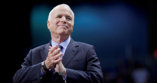 FILE PHOTO: U.S. Republican presidential nominee Senator John McCain (R-AZ) listens as he is introduced at a campaign rally in Fayetteville, North Carolina, U.S. on October 28, 2008.   REUTERS/Brian Snyder/File Photo - RTX3C5AF
