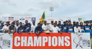 Sri Lankan cricketers pose for photographers after victory in the final day of a one-off Test match between Sri Lanka and Zimbabwe at the R Premadasa Cricket Stadium in Colombo on July 18, 2017. / AFP PHOTO / ISHARA S. KODIKARA        (Photo credit should read ISHARA S. KODIKARA/AFP/Getty Images)