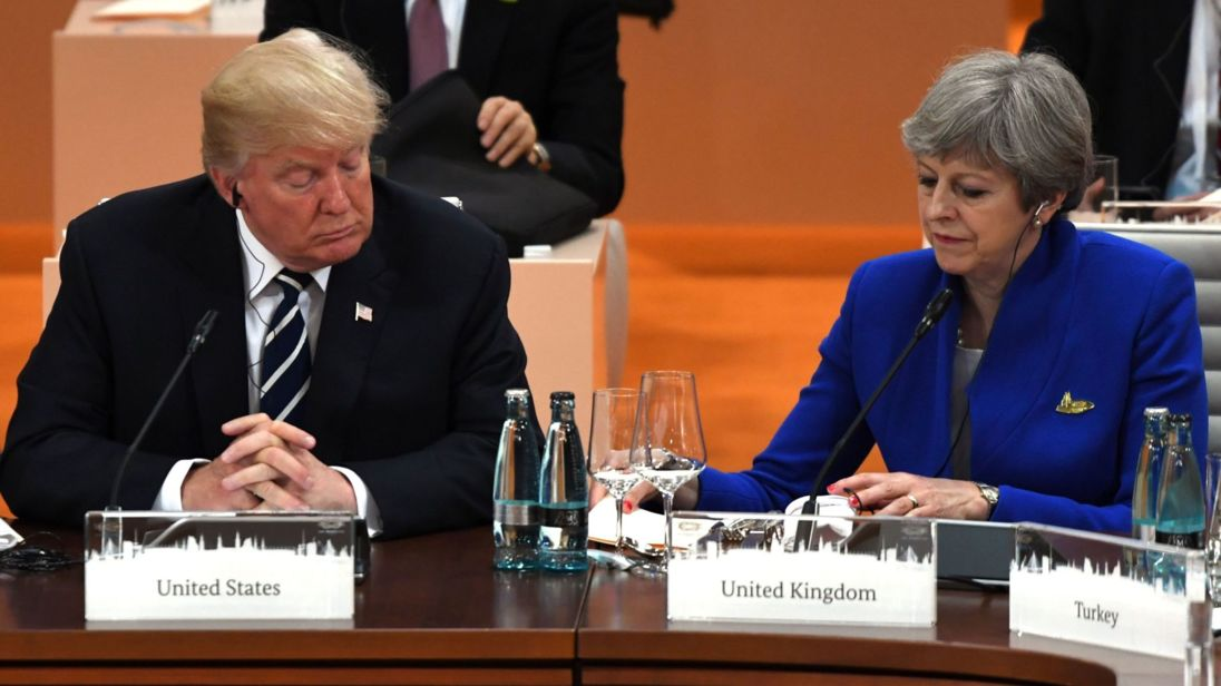US President Donald Trump (L) and Britain's Prime Minister Theresa May attend a working session on the first day of the G20 summit in Hamburg, northern Germany, on July 7, 2017. Leaders of the world's top economies gather from July 7 to 8, 2017 in Germany for likely the stormiest G20 summit in years, with disagreements ranging from wars to climate change and global trade. / AFP PHOTO / Patrik STOLLARZ (Photo credit should read PATRIK STOLLARZ/AFP/Getty Images)