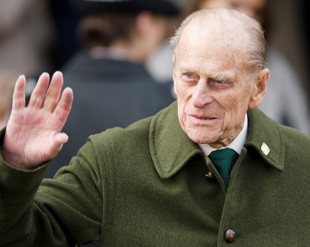 Britain's Prince Philip, Duke of Edinburgh waves to well-wishers as he leaves following the Royal family Christmas Day church service at St Mary Magdalene Church in Sandringham, Norfolk, in the east of England, on December 25, 2012. AFP PHOTO / LEON NEAL