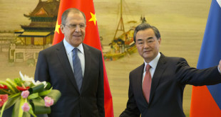 Chinese Foreign Minister Wang Yi, right gestures next to Russian Foreign Minister, Sergey Lavrov before they leave after a joint press conference held at the Chinese Foreign Ministry in Beijing, China, Friday, April 29, 2016. (AP Photo/Ng Han Guan)