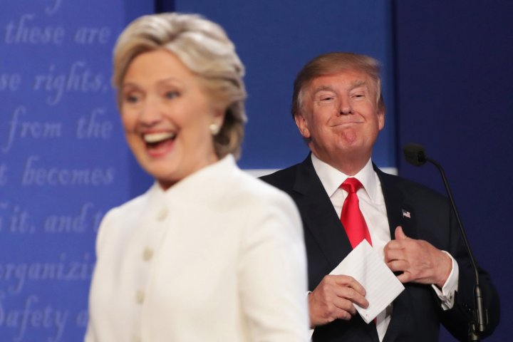 LAS VEGAS, NV - OCTOBER 19:  Democratic presidential nominee former Secretary of State Hillary Clinton walks off stage as Republican presidential nominee Donald Trump smiles after the third U.S. presidential debate at the Thomas & Mack Center on October 19, 2016 in Las Vegas, Nevada. Tonight is the final debate ahead of Election Day on November 8.  (Photo by Chip Somodevilla/Getty Images)