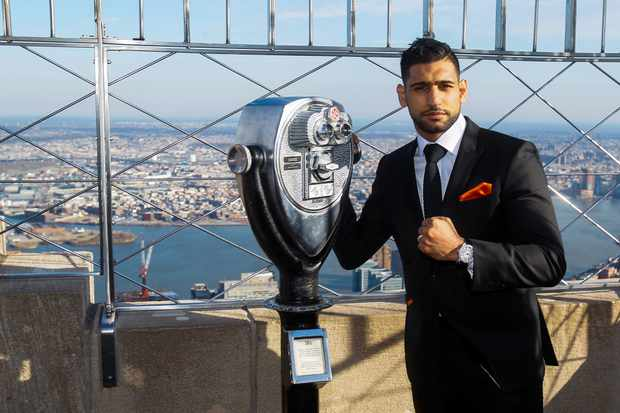 NEW YORK, NY - MARCH 01: Amir Khan poses for photos during a press event to promote his fight against Canelo Alvarez at the Empire State Building on March 1, 2016 in New York City. (Photo by Alex Goodlett/Getty Images)