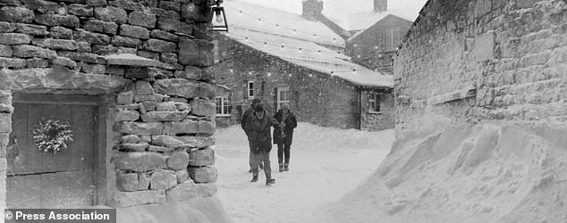 Embargoed to 0001 Sunday November 12 Undated handout image issued by Waitrose of a still from their Christmas advert which features the story of villagers who find themselves snowed in at the highest pub in Britain for Christmas lunch. PRESS ASSOCIATION Photo. Issue date: Sunday November 12, 2017. The grocer's Christmas campaign is set at the remote 17th century Tan Hall Inn near Richmond in the Yorkshire Dales, where drinkers have been snowed in at 1,732 feet some 50 times since 2005. See PA story CONSUMER Waitrose. Photo credit should read: Waitrose/PA Wire NOTE TO EDITORS: This handout photo may only be used in for editorial reporting purposes for the contemporaneous illustration of events, things or the people in the image or facts mentioned in the caption. Reuse of the picture may require further permission from the copyright holder.