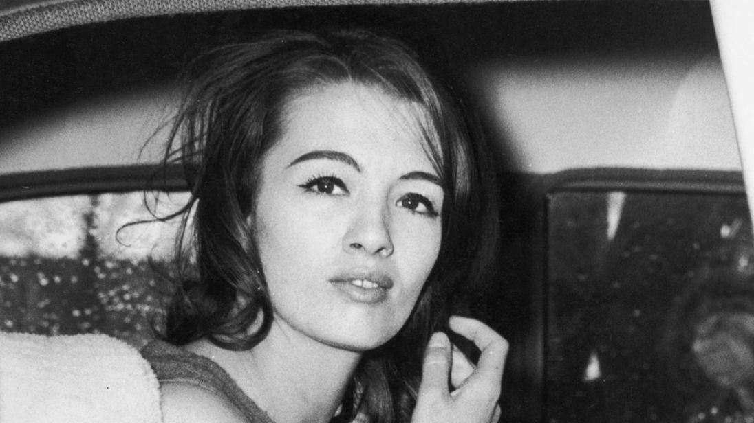 Christine Keeler leaving the Ariel Hotel, London, after her return from Spain, 29th March 1963. Two weeks previously, she had failed to give evidence in the trial of her former boyfriend John Edgecombe.  (Photo by Central Press/Hulton Archive/Getty Images)