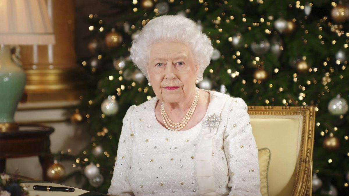 In this photo released on Monday, Dec. 25, 2017, Britain's Queen Elizabeth sits at a desk in the 1844 Room at Buckingham Palace, after recording her Christmas Day broadcast to the Commonwealth, in London. (Pool Photo via AP)