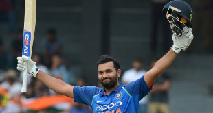 Indian cricketer Rohit Sharma raises his bat and helmet in celebration after scoring a century (100 runs) during the fourth one day international (ODI) cricket match between Sri Lanka and India at R. Premadasa Stadium in Colombo on August 31, 2017. / AFP PHOTO / LAKRUWAN WANNIARACHCHI        (Photo credit should read LAKRUWAN WANNIARACHCHI/AFP/Getty Images)