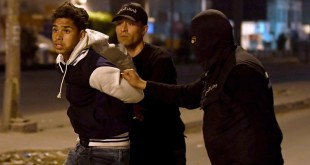 300 arrested in third night of Tunisia's violent protests