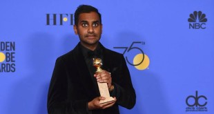 """Aziz Ansari poses in the press room with the award for best performance by an actor in a television series - musical or comedy for """"Master of None"""" at the 75th annual Golden Globe Awards at the Beverly Hilton Hotel on Sunday, Jan. 7, 2018, in Beverly Hills, Calif. (Photo by Jordan Strauss/Invision/AP)"""