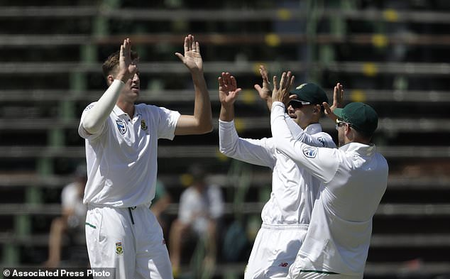 South Africa's bowler Morne Morkel' left, celebrates with teammates after dismissing India's batsman Ajinkya Rahane for 9 runs on the first day of the third cricket test match between South Africa and India at the Wanderers Stadium in Johannesburg, South Africa, Wednesday, Jan. 24, 2018. (AP Photo/Themba Hadebe)