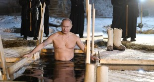 Putin takes holy dip in icy waters