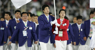 MACAU, CHINA:  Athletes from both North and South Korea walk together under a unified Korean flag at the Macau Stadium during the opening ceremony of  the 4th East Asian Games in Macau, 29 October 2005.  The Games will be held 29 October to 06 November.  AFP PHOTO/Antony DICKSON  (Photo credit should read ANTONY DICKSON/AFP/Getty Images)