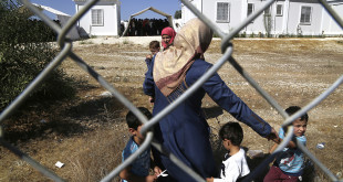 Migrants women from Syria walk with their children in a refugee camp in Kokkinotrimithia, outside of the capital Nicosia, in the eastern Mediterranean island of Cyprus, on Sunday, Sept. 10, 2017. Cyprus police say a 36-year-old man was arrested Sunday for allegedly driving one of a pair of boats that brought 305 Syrian refugees to the island's northwestern coast. (AP Photo/Petros Karadjias)