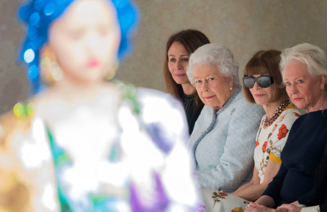 Mandatory Credit: Photo by NEIL HALL/EPA-EFE/REX/Shutterstock (9424609aa) Caroline Rush, Queen Elizabeth II and Anna Wintour Emilio de la Morena - Runway - London Fashion Week FW 18/19, United Kingdom - 20 Feb 2018 Britain's Queen Elizabeth II (2-L) sits with Chief Executive of the British Fashion Council Caroline Rush (L) and Editor-in-chief of Vogue magazine Anna Wintour (2-R) as models present creations by British designer Richard Quinn during the London Fashion Week, in London, Britain, 20 February 2018. The presentation of the Women's Fall-Winter 2018/2019 collections runs from 15 to 20 February.
