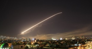 A missile trail lights up the night sky over Damascus Photograph Hassan Ammar AP