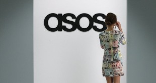 A model walks on an in-house catwalk at the ASOS headquarters in London