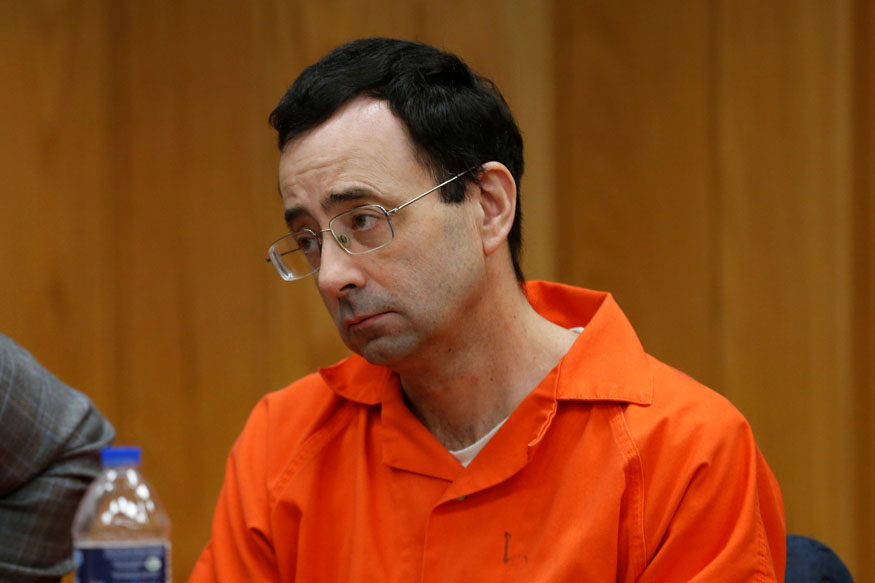 Larry Nassar, a former team USA Gymnastics doctor who pleaded guilty in November 2017 to sexual assault charges, sits in the courtroom during his sentencing hearing in the Eaton County Court in Charlotte, Michigan, U.S., February 2, 2018.   REUTERS/Rebecca Cook