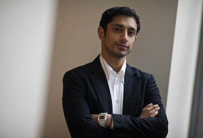 Riz Ahmed of Britain poses for pictures during a presentation of Shooting Stars, a selection of upcoming actors, at the 62th Berlinale International Film Festival in Berlin February 13, 2012.   REUTERS/Thomas Peter (GERMANY  - Tags: ENTERTAINMENT) - RTR2XRYO